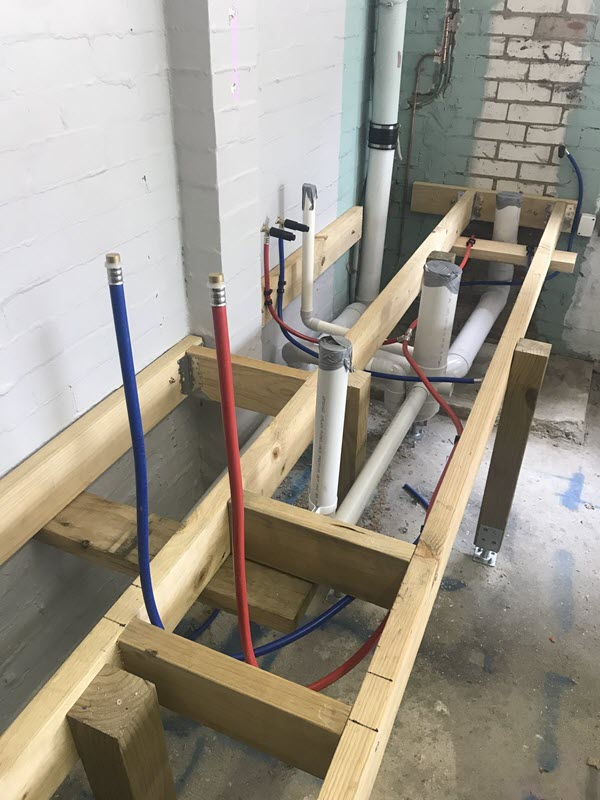form work and plumbing for bathroom conversion
