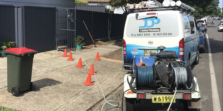 The J Dalton Plumbing van set up for drain clearing